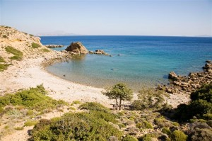 A beautiful beach in a hidden bay on the island of Kos in Greece