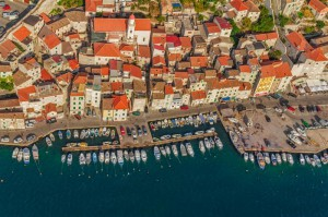 Aerial helicopter shoot of Sibenik old town, Croatia.